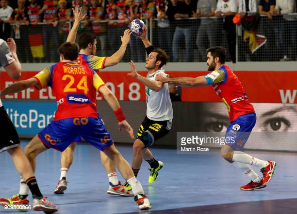 Uwe Gensheimer of Germany challenges David Balaguer of Spain during the Men's Handball European Championship main round match between Germany and...