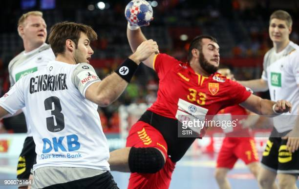 Uwe Gensheimer of Germany fights for a ball with Zharko Peshevski of Macedonia during the preliminary round group C match of the Men's 2018 EHF...