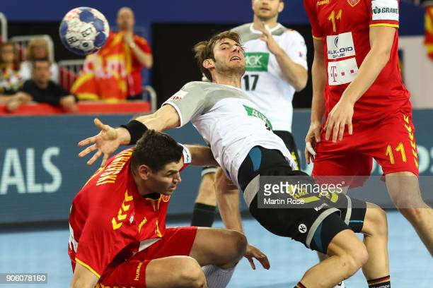 Uwe Gensheimer of Germany is challenged by Ace Jonovski of Macedonia during the Men's Handball European Championship Group C match between Germany...