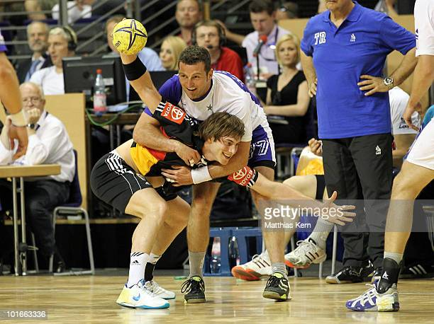 Uwe Gensheimer of Germany is challenged by Florian Kehrmann of Allstars during a friendly match between Germany and the Handball Bundesliga Allstars...