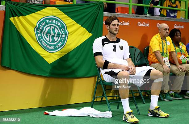 Uwe Gensheimer of Germany is seen on a chair after receiving the red card during the Mens Preliminary Group B match between Brazil and Germany at...