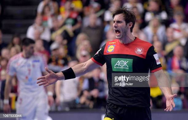 Uwe Gensheimer of Germany reacts during the 26th IHF Men's World Championship group 1 match between Croatia and Germany at Lanxess Arena on January...