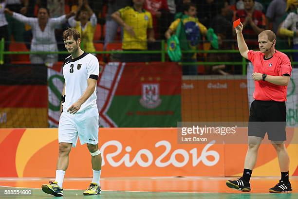 Uwe Gensheimer of Germany recieves the red card during the Mens Preliminary Group B match between Brazil and Germany at Future Arena on August 11...