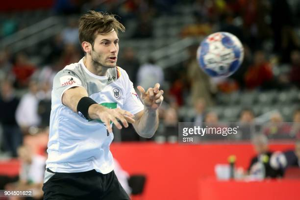 Uwe Gensheimer of Germany shoots during the preliminary round group C match of the Men's 2018 EHF European Handball Championship between Germany and...