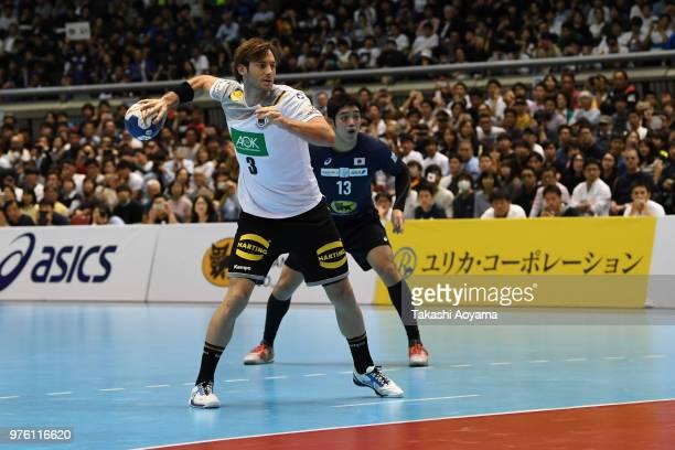 Uwe Gensheimer of Germany takes a penalty shot during the handball international match between Japan and Germany at the Tokyo Metropolitan Gymnasium...