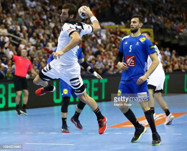 Uwe Gensheimer of Germany throws a goal during the 26th IHF Men's World Championship group A match between Germany and France at MercedesBenz Arena...