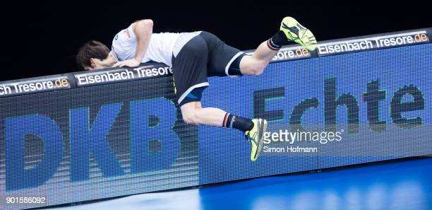 Uwe Gensheimer of Germany tries to pick up the ball behind the advertising board during the International Handball Friendly match between Germany and...