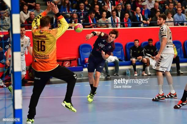 Uwe Gensheimer of PSG beats goalkeeper William Annotel of Dunkerque during the Lidl Star Ligue match between Paris Saint Germain and Dunkerque at...