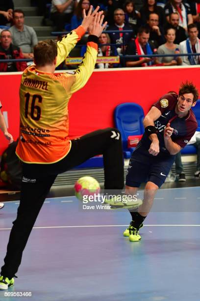 Uwe Gensheimer of PSG beats William Annotel of Dunkerque during the Lidl Star Ligue match between Paris Saint Germain and Dunkerque at Salle Pierre...
