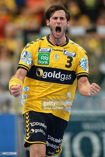 Uwe Gensheimer of RheinNeckar Loewen celebrates a goal during the DHB cup quarter final match between RheinNeckar Loewen and THW Kiel at SAP Arena on...