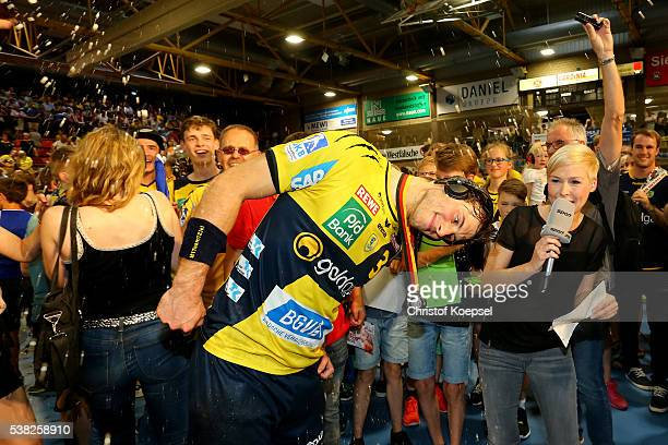 Uwe Gensheimer of RN Loewen iss poured with beer during an interview with Anett Sattler of SPORT 1 after winning the German Championships after the...