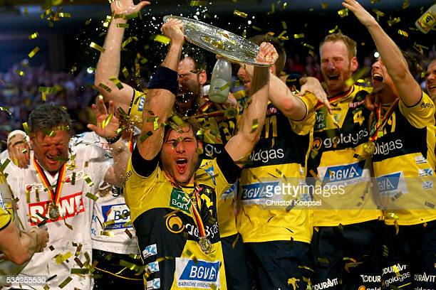 #Uwe Gensheimer of RN Loewen lifts the German Championship trophy after the DKB Handball Bundesliga match between TuS NLuebbecke and RN Loewen at...