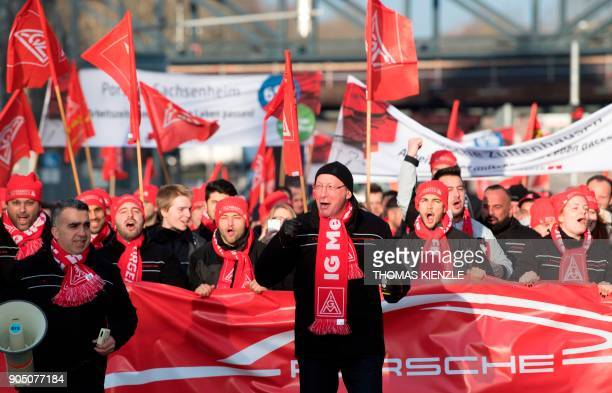Uwe Hueck the head of German luxury car maker Porsche's works council shouts slogans during a demonstration as part of a warning strike on January 15...