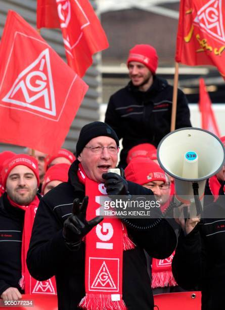 Uwe Hueck the head of German luxury car maker Porsche's works council speaks during a demonstration as part of a warning strike on January 15 2018 in...