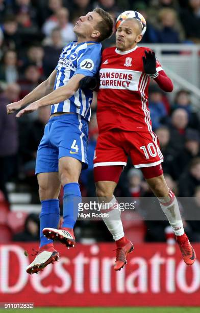 Uwe Huenemeier of Brighton and Hove Albion battles for a header with Martin Braithwaite of Middlesbrough during The Emirates FA Cup Fourth Round...