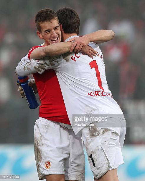 Uwe Huenemeier of Cottbus and team mate Thorsten Kirschbaum show their delight aftre winning the Second Bundesliga match between FC Energie Cottbus...