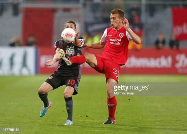 Uwe Huenemeier of Cottbus battles for the ball with Albert Bunjaku of Kaiserslautern during the Second Bundesliga match between FC Energie Cottbus...