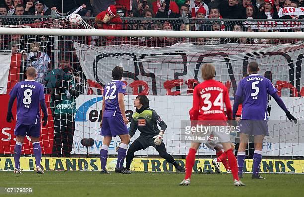 Uwe Huenemeier of Cottbus scores the sixt goal during the Second Bundesliga match between FC Energie Cottbus and Erzgebirge Aue at Stadion der...