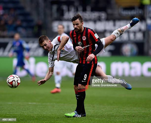 Uwe Huenemeier of SC Paderborn 07 challenges Haris Seferovic of Eintracht Frankfurt during the Bundesliga match between Eintracht Frankfurt and SC...