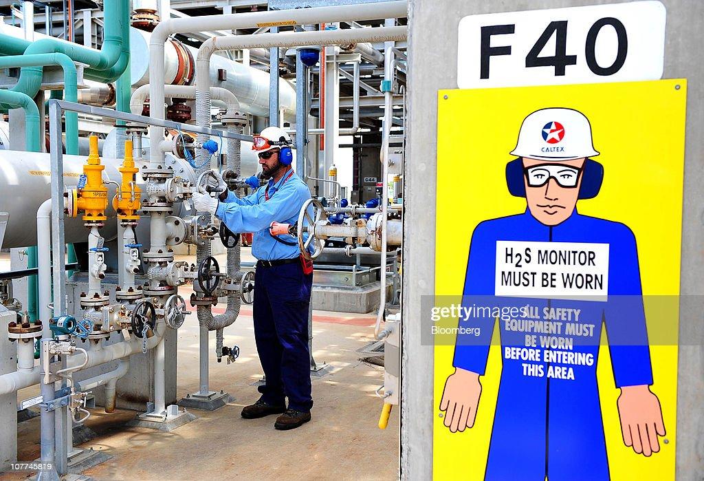 Uwe Klimmer, senior area operator, checks the diesel hydrotreater unit at Caltex Australia Ltd.'s Lytton refinery in Brisbane, Australia, on Tuesday, Dec. 21, 2010. Caltex Australia is the nation's biggest oil refiner. Photographer: Eric Taylor/Bloomberg via Getty Images