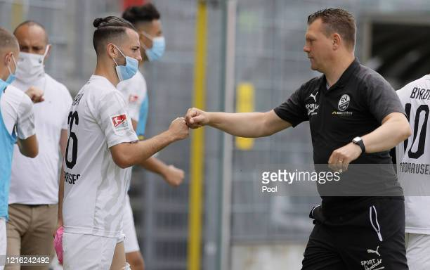 Uwe Koschinat Manager of Sandhausen and Besar Halimi celebrate victory following the Second Bundesliga match between SV Sandhausen and Hannover 96 at...