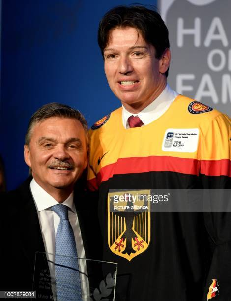Uwe Krupp former ice hockey player for Germany and former coach of the German ice hockey squad embraces the President of the IIHF René Fasel in...