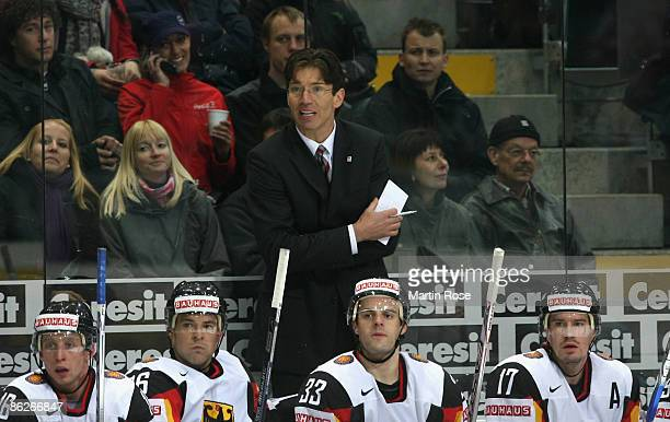 Uwe Krupp, head caoch of Germany looks dejected during the IIHF World Ice Hockey Championship preliminary round, group B match between France and...