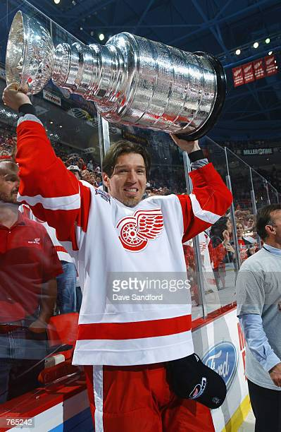 Uwe Krupp of the Detroit Red Wings raises the Stanley Cup after defeating the Carolina Hurricanes during game five of the NHL Stanley Cup Finals on...
