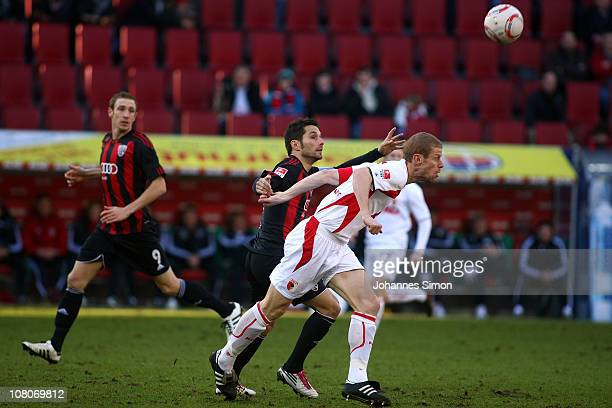 Uwe Moehrle of Augsburg and Stefan Leitl of Ingolstadt fight for the ball during the Second Bundesliga match between FC Augsburg v FC Ingolstadt at...