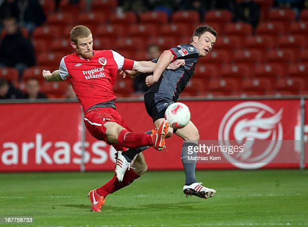 Uwe Moehrle of Cottbus battles for the ball with Alexander Baumjohann of Kaiserslautern during the Second Bundesliga match between FC Energie Cottbus...