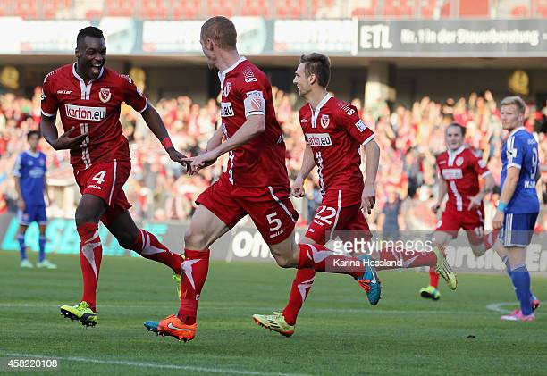 Uwe Moehrle of Cottbus celebrates the opening goal with Cedric Mimbala during the 3Liga match between Energie Cottbus and SpVgg Unterhaching at...
