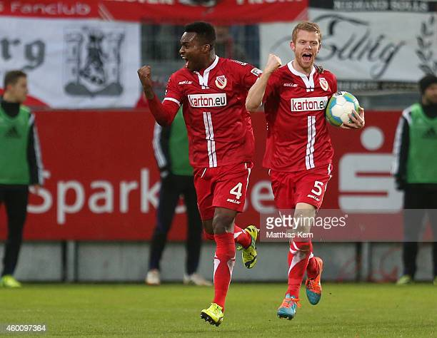 Uwe Moehrle of Cottbus jubilates with team mate Ebewa Yam Mimbala after scoring the fourth goal during the third league match between FC Energie...
