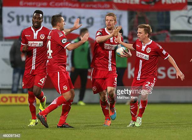 Uwe Moehrle of Cottbus jubilates with team mates after scoring the fourth goal during the third league match between FC Energie Cottbus and VFL...