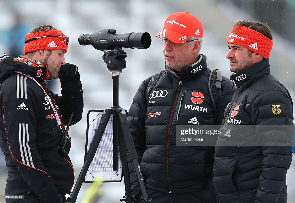 Uwe Muessiggang (C), head coach of Germany talks to assistant coach Mark Kirchner (L) and team docotr Michael Koch (R) during an offical training session during the IBU Biathlon World Championships at Vysocina Arena on February 8, 2013 in Nove Mesto na Morave, Czech Republic.