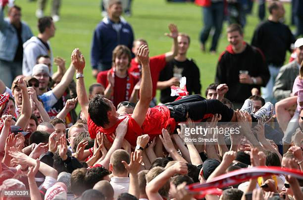 Uwe Neuhaus, head coach of 1.FC Union Berlin is airborned by his fans, who celebrate the ascension of 1.FC Union Berlin to the 2. Bundesliga after...