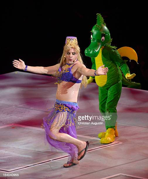 Uwe Ochsenknecht aka Lady of the Camellias and the dragon Tabaluga perform during the premiere of 'Tabaluga Und Die Zeichen Der Zeit' Premiere on...