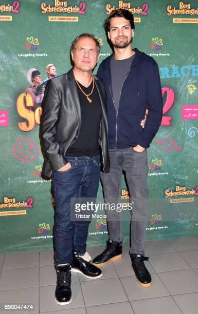 Uwe Ochsenknecht and his son Jimi Blue Ochsenknecht attend the 'Burg Schreckenstein 2' premiere on December 10 2017 in Berlin Germany