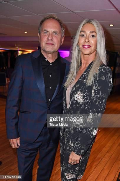 Uwe Ochsenknecht and his wife Kirsten Kiki Viebrock attend the world premiere of the movie Ich war noch niemals in New York at Cinedom on October 9...