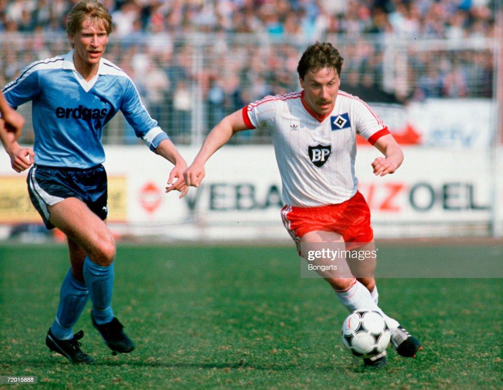 Uwe Rahn of Gladbach and Wolfram Wuttke of Hamburg in action during the bundesliga match between Hamburger SV and Borussia Moenchengladbach on April 14, 1984 in Hamburg, Germany.
