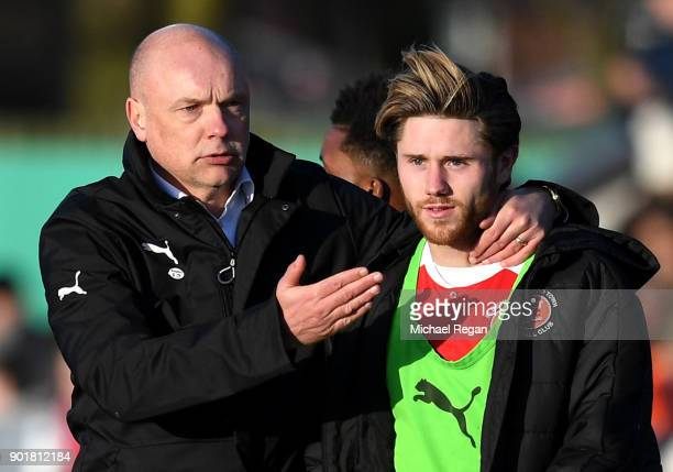 Uwe Rosler manager of Fleetwood Town congratulates Wes Burns of Fleetwood Town after The Emirates FA Cup Third Round match between Fleetwood Town and...