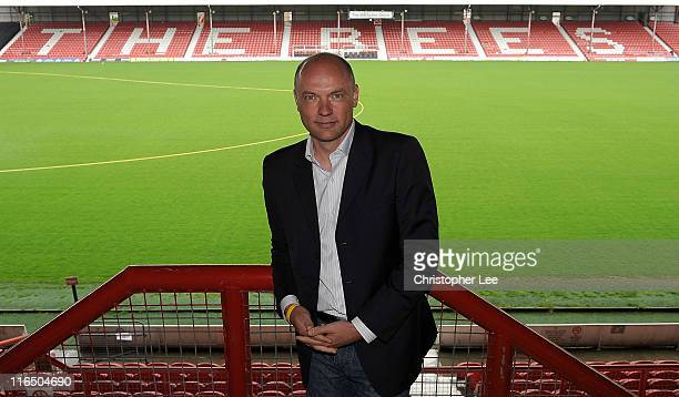 Uwe Rosler poses pitchside as he is announced as the new manager of Brentford FC at Griffin Park on June 16 2011 in Brentford England