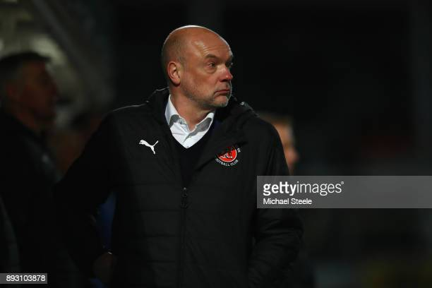 Uwe Rosler the manager of Fleetwood Town looks on during the Emirates FA Cup second round replay match between Hereford FC and Fleetwood Town at...