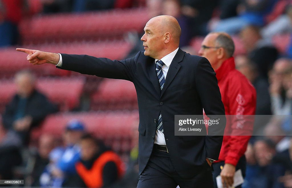 Uwe Rosler the manager of Wigan Athletic gives instructions to his players during the Sky Bet Championship Play Off Semi Final first leg match between Wigan Athletic and Queens Park Rangers at DW Stadium on May 9, 2014 in Wigan, England.