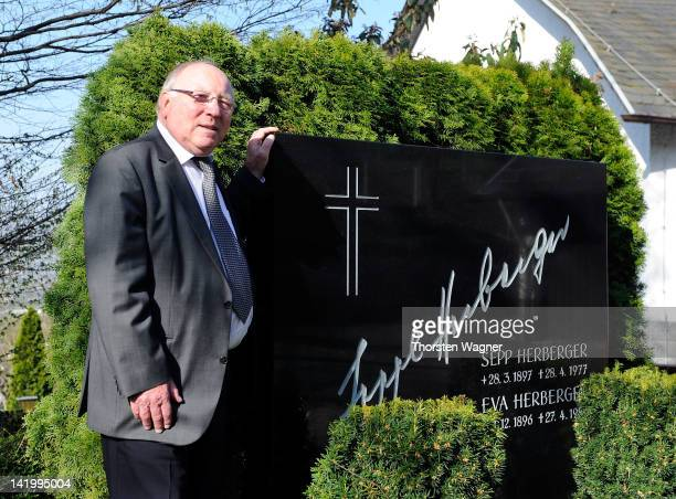 Uwe Seeler is pictured at the grave of Sepp Herberger during wreathlaying ceremony at Sepp Herberger's final resting place at Bergfriedhof on March...