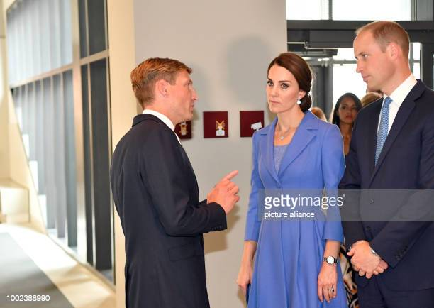 UweNeumaerker Director of the Foundation Memorial to the Murdered Jews of Europe talks to Britain's Prince William and his wife CatherineDuchess of...
