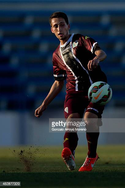 Uxio Marcos of Cordoba CF strikes the ball during the friendly football match between Marbella FC and Cordoba CF at Municipal Stadium on July 27 2014...