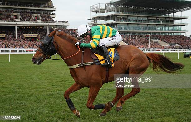 Uxizandre ridden by A.P McCoy drives for the finishing line to win the Ryanair Chase during St Patrick's Thursday at the Cheltenham Festival at...