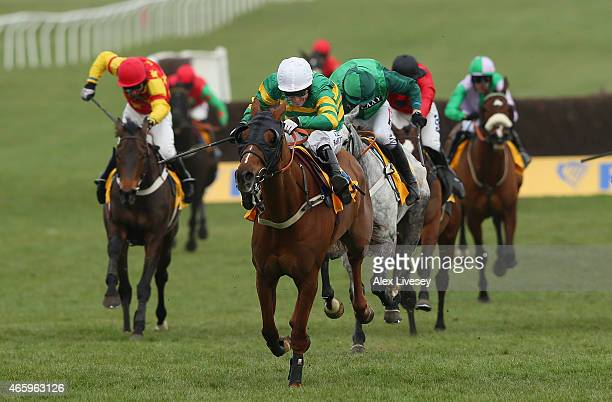 Uxizandre ridden by AP McCoy drives for the finishing line to win the Ryanair Chase during St Patrick's Thursday at the Cheltenham Festival at...
