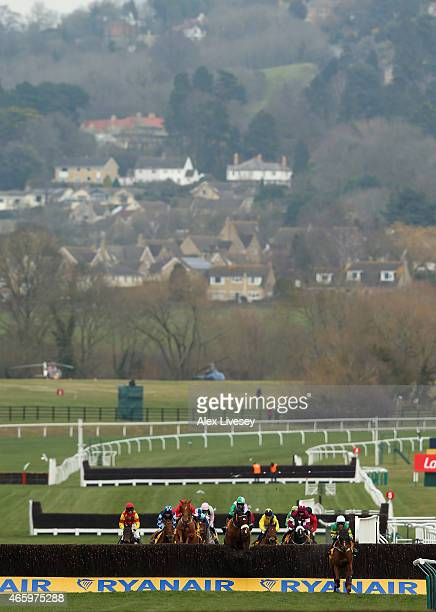 Uxizandre ridden by Tony McCoy leads the field during their victory in the Ryanair Chase during St Patrick's Thursday at the Cheltenham Festival at...