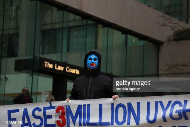 Uyghur activists protest China's treatment of Uyghurs outside a court on the first day of Huawei Technologies Chief Financial Officer Meng Wanzhou...